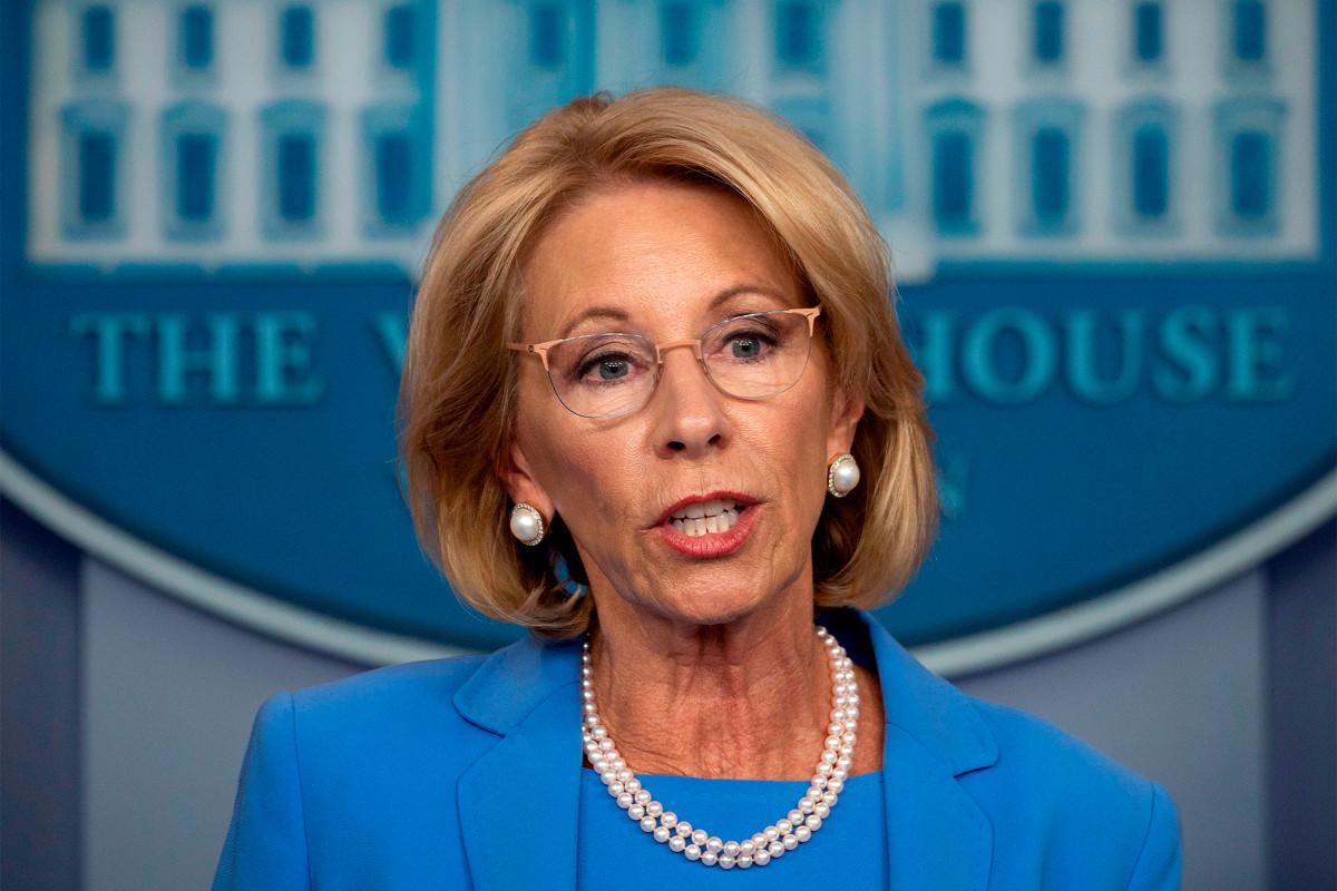 DeVos issues rule steering more virus aid to private schools