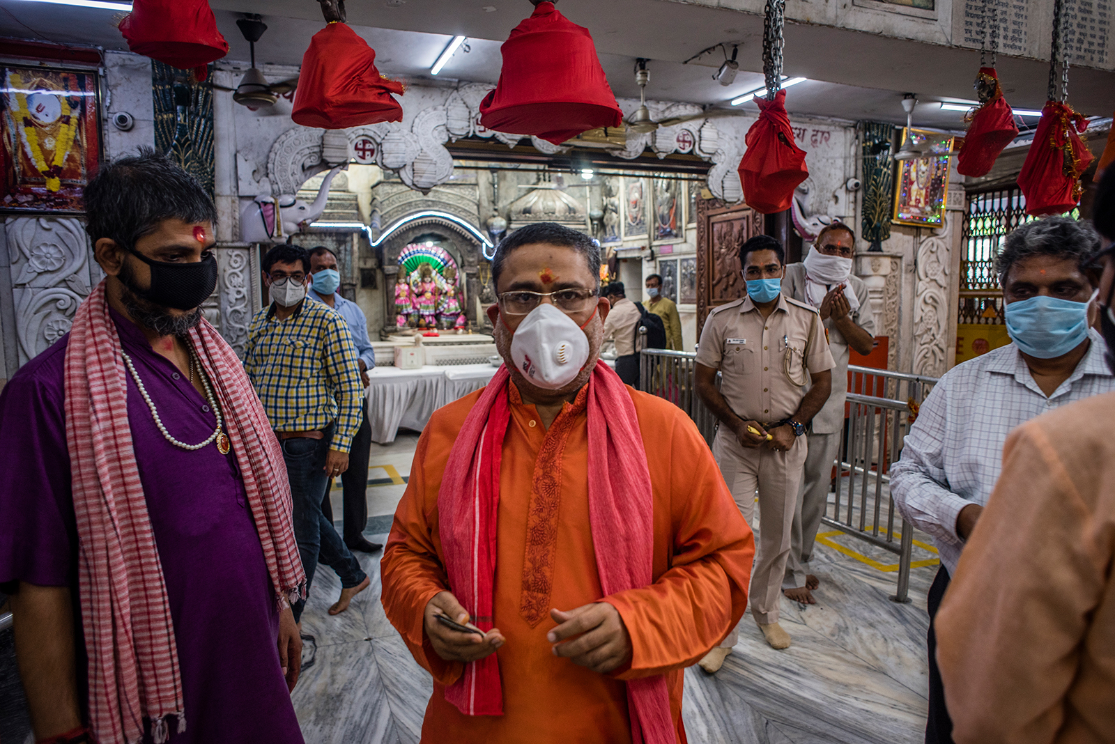 Indian Hindu priests and devotees walk inside Hunuman Mandir, on June 8, in Delhi.