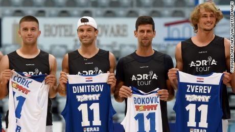 Borna Coric, Grigor Dimitrov, Novak Djokovic  and Alexander Zverev (left to right) pose for a group shot ahead of an exhibition basketball match in Zadar, Croatia.