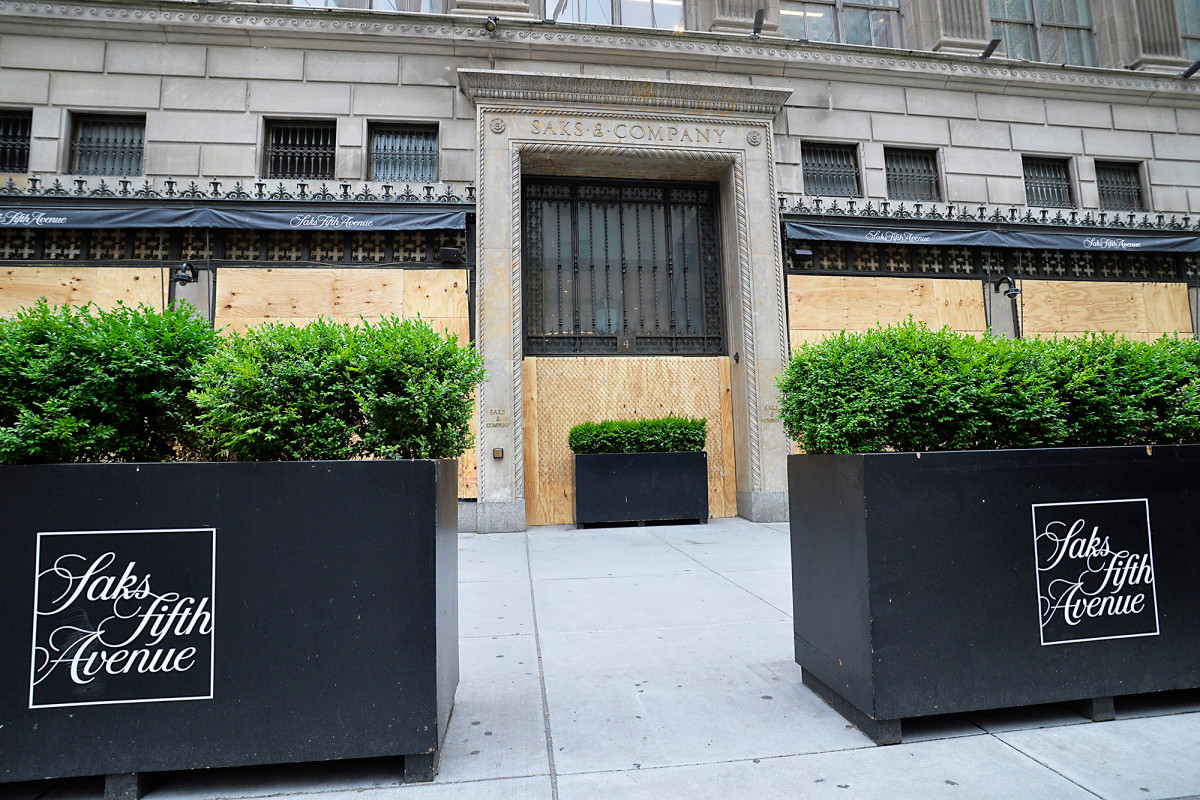 Saks Fifth Avenue swaps fencing for display windows for reopening