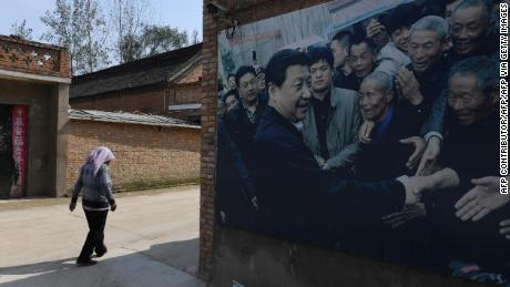 This photo taken in September 2017 shows A billboard featuring a photo of China's President Xi Jinping visiting residents in Zhangzhuang village in Lankao in China's central Henan province.