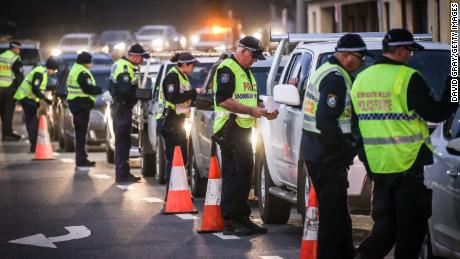Police stop and question drivers at a checkpoint on July 8 in Albury, Australia.