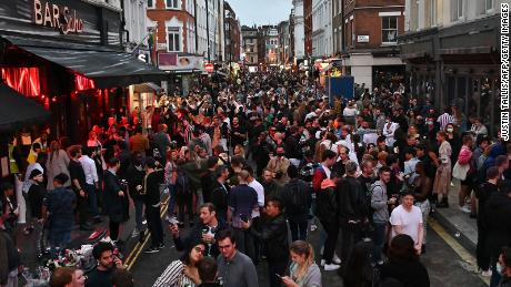 Revellers pack a street outside bars in the Soho area of London on July 4, as restrictions are further eased.