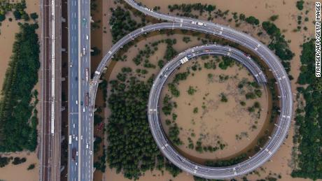 This aerial view shows a bridge leading to the inundated Tianxingzhou island in Wuhan in China's central Hubei province on July 13.