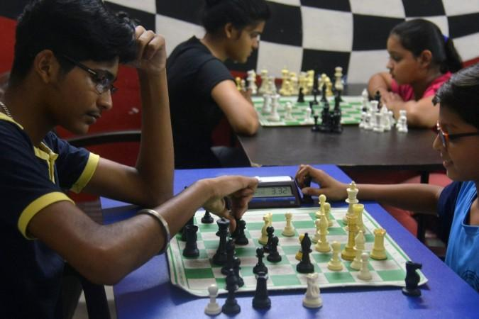Indian students play chess