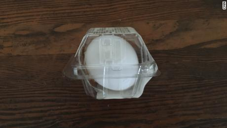 A convenience store hard-boiled egg is protected in plastic packaging.