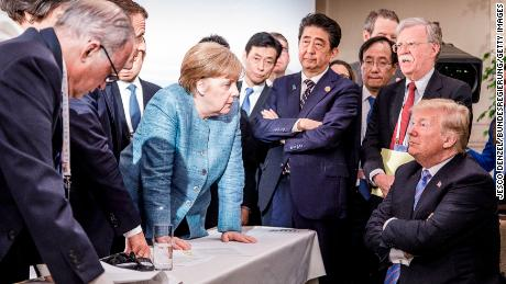 "After a rancorous G7 summit in 2018 in Canada and a ""somewhat depressing"" outcome, Merkel's office released this photo."