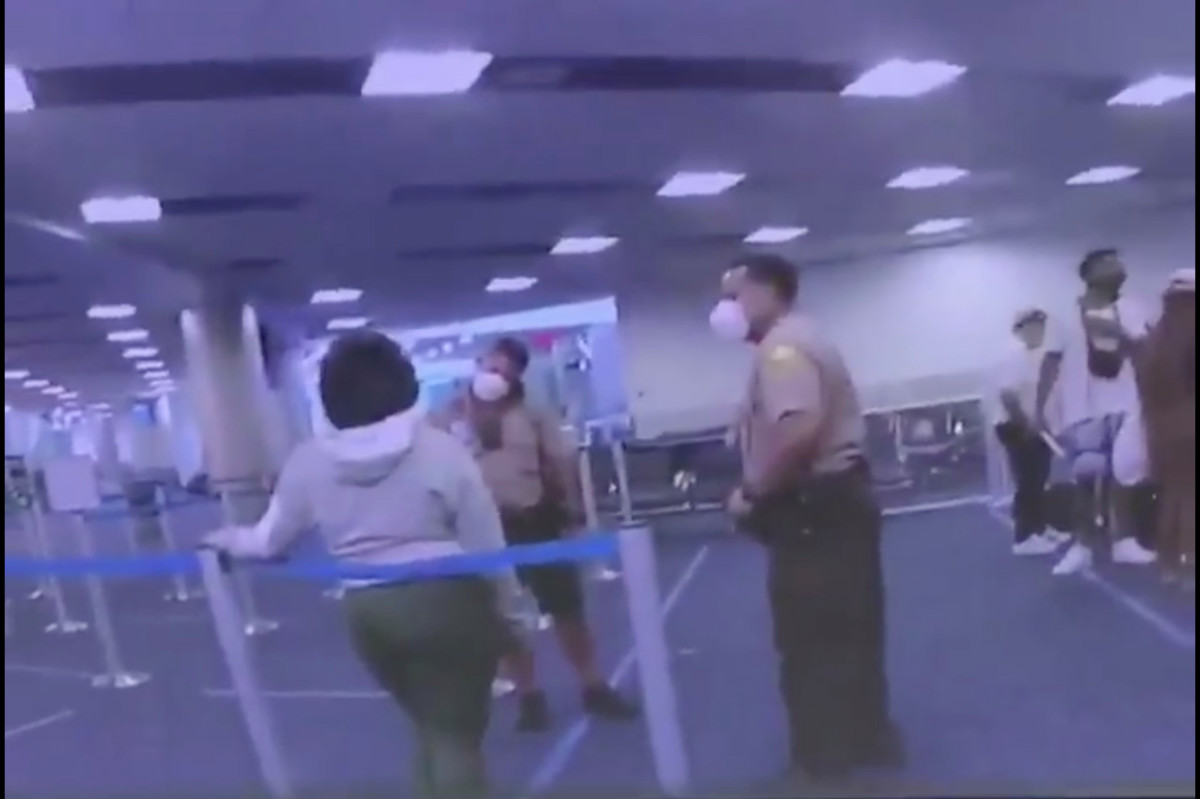 Cop slugs woman in the face at Miami International Airport, video shows