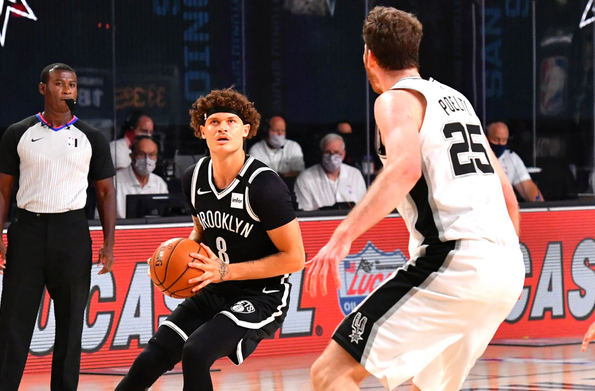 Nets rebound from ugly scrimmage opener to topple Spurs