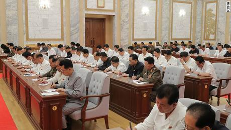 North Korean leader Kim Jong Un is seen at the Thursday meeting in this photograph provided by KCNA. Officials do not appear to be wearing masks or practicing social distancing.