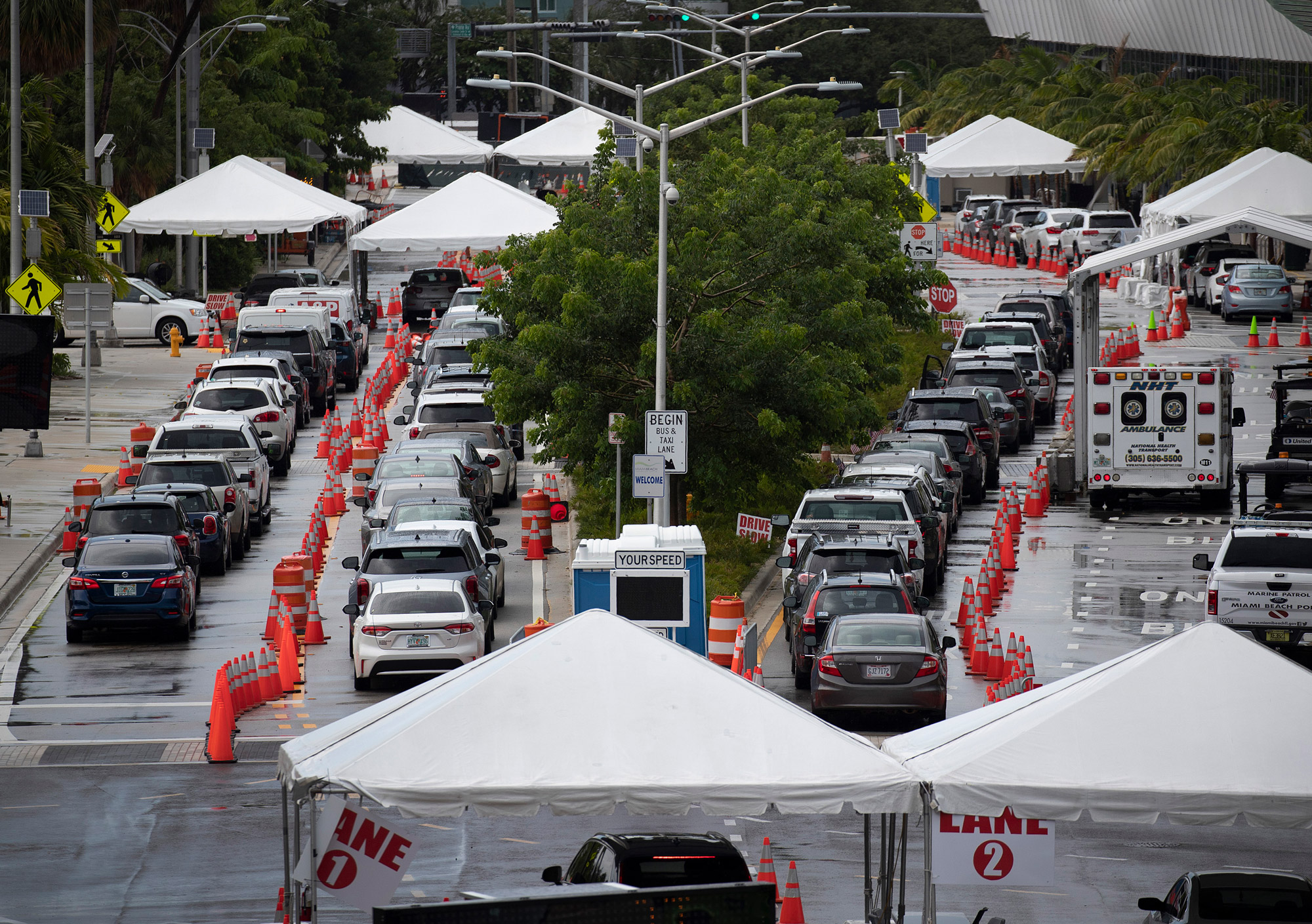 Cars are seen in line as the drivers wait to be tested for COVID-19 at the COVID test site located at the Miami Beach Convention Center on July 13 in Miami Beach, Florida.