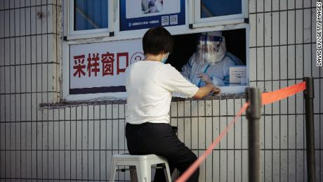 A woman receives a Covid-19 nucleic acid test at the First Affiliated Hospital of Xinjiang Medical University on June 25 in Urumqi, China.