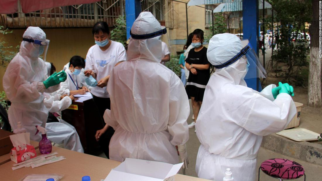 Xinjiang capital in lockdown over spike in coronavirus cases