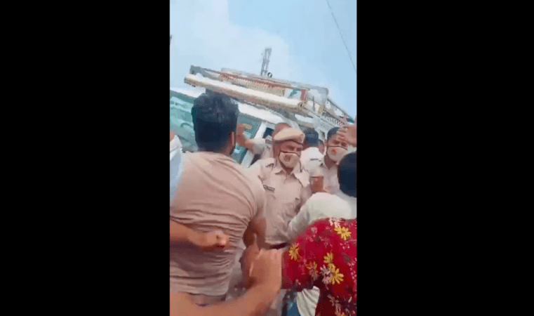 Police try to push back mob