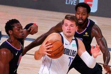 Doncic makes history but Mavericks fall to Clippers after Porzingis ejection