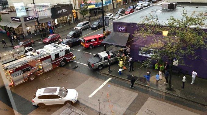 Pedestrian struck, thrown through Vancouver shop window by motorist