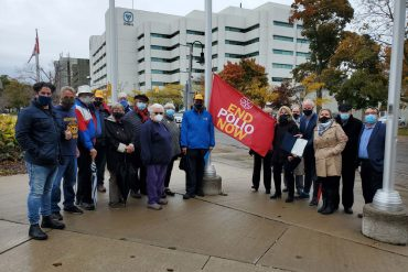 Raising the flag for World Polio Day