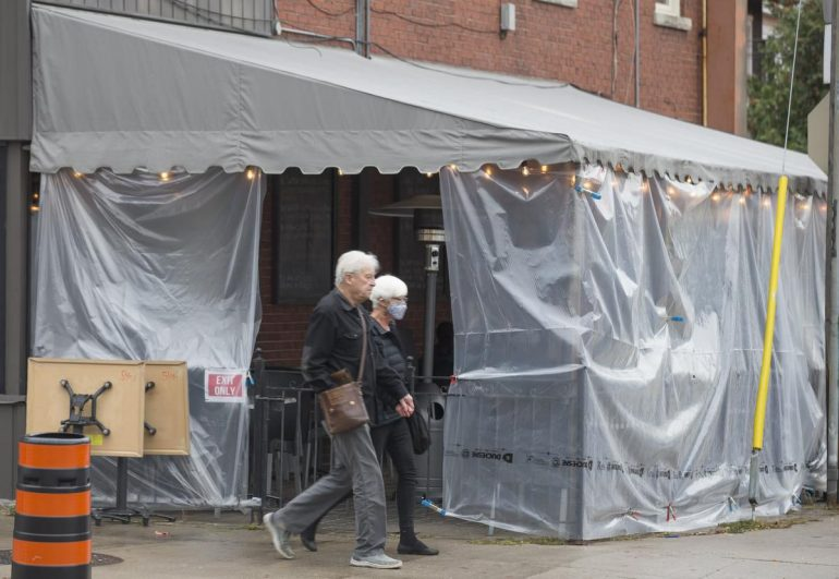 Queen's Pasta Cafe, on Bloor Street West, has tented its patio as restaurants look for ways to keep going after Toronto reverted back to a modified version of Stage 2.