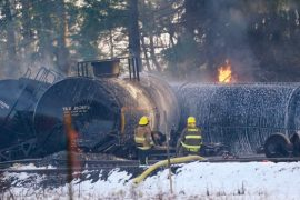 Train cars carrying crude oil derail, burn north of Seattle
