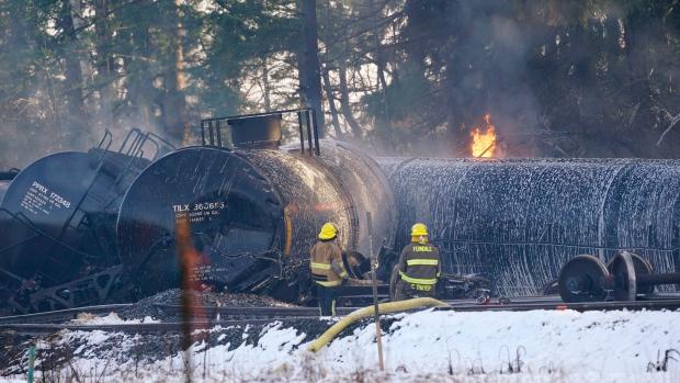 Train cars carrying crude oil derail, burn north of Seattle