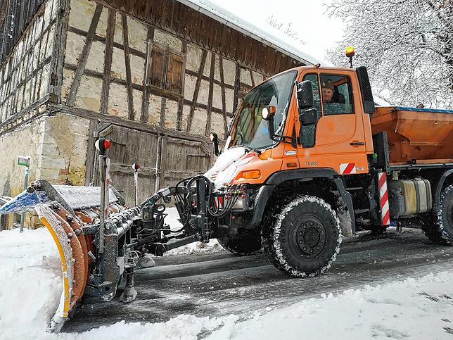 Winter service with Unimog (universal motorized device) in the community of Muhalingan.  Here Peter Trebber who was making sure vehicles pass through the farm road near Heuchel.