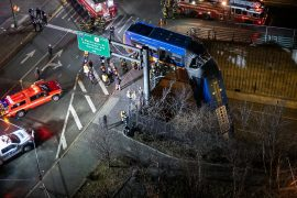 Crashed through barriers: New York bus hangs down from bridge