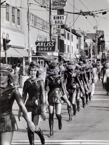 The girls of the Ulm Guard pass through the industrial city of Hamilton.