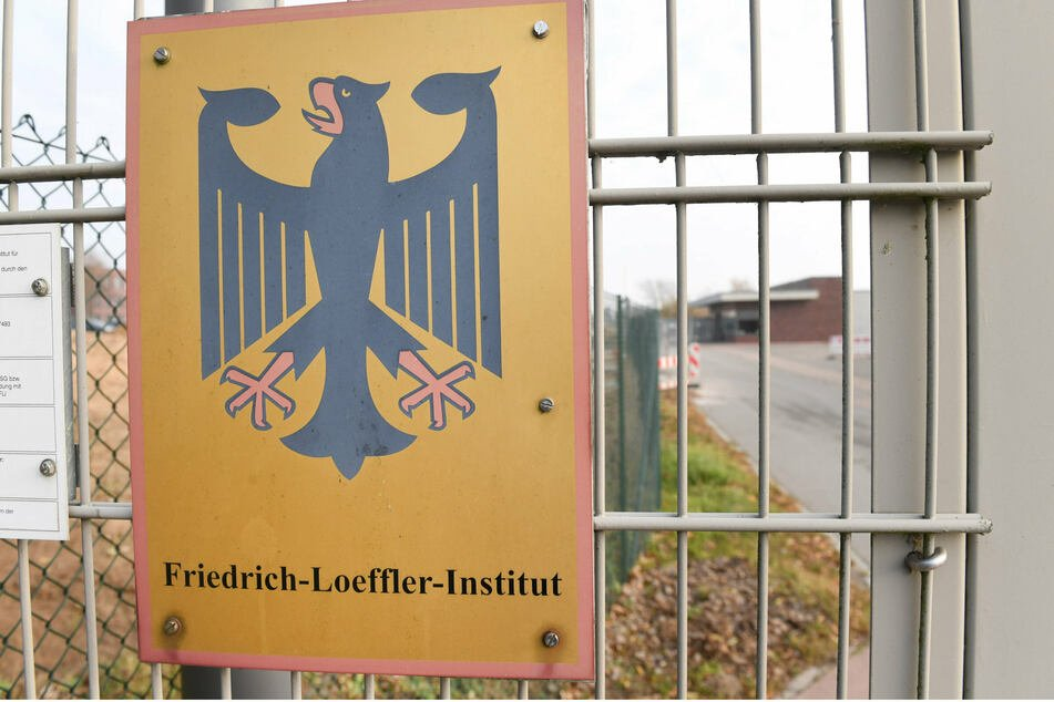 A sign with a Confederate Eagle hangs in the entrance area of the Frederick Loeffler Institute for Animal Health (FLI) on Rims Island near Greifswald.