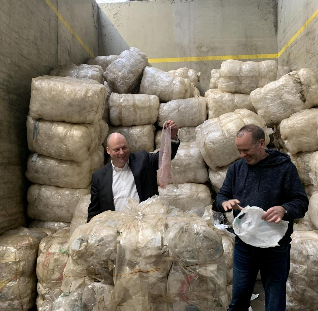 Soren Dede (left) and Gunther Bonin in front of four tons of plastic waste they imported from Cambodia to Germany