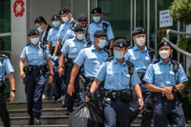 """Hong Kong: Police break into editorial office of """"Apple Daily"""" and arrest editors"""