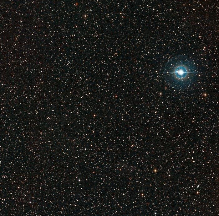 The sky around the pale orange dwarf star PDS 70 (center of photo).