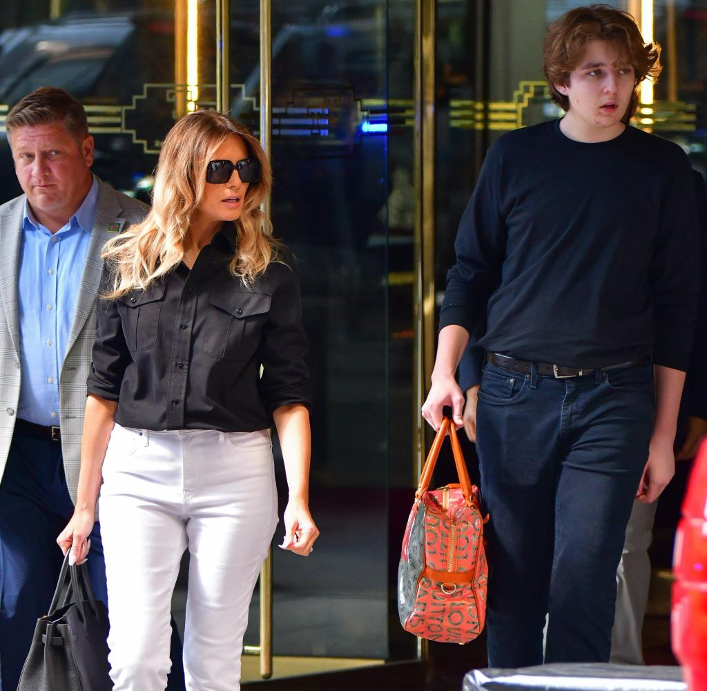 Former First Lady Melania Trump leaves Trump Tower in New York with her son Barron