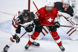 Spooner scored twice in women's hockey worlds for Canada in a 5–0 win over Switzerland.