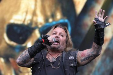 Motley Fool Crew singer Vince Neal falls off stage at a concert